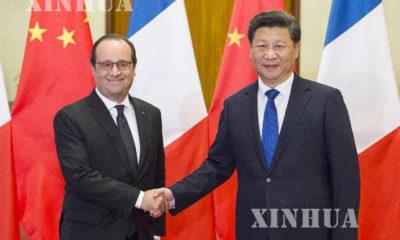 တရုတ္ႏိုင္ငံ သမၼတ ရွီက်င့္ဖိန္ (ယာ) ႏွင့္ ျပင္သစ္ႏိုင္ငံ သမၼတ Francois Hollande တို႔ အား ႏိုဝင္ဘာ ၂ ရက္ေန႔က ေပက်င္း ၿမိဳ႕ရွိ ျပည္သူ႕ခန္းမႀကီးတြင္ ေတြ႕ရစဥ္ (ဆင္ဟြာ)