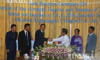 ငလ်င္ဒဏ္ေၾကာင့္ထိခိုက္ပ်က္စီးခဲ႔ရေသာပုဂံဘုရားပုထိုးမ်ားျပဳ ျပင္ရန္ Huawei Technologies (Yangon) Co. Ltd., ကေငြလွဴဒါန္းပြဲအခမ္းအနားက်င္းပစဥ္ (ဆင္ဟြာ)