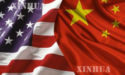 တရုတ္-အေမရိကန္ ႏွစ္ႏုိင္ငံအလံအား အတူတကြေတြ ့ရစဥ္(ဆင္ဟြာ)