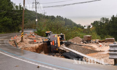 မီတက်( Mitag )တိုက်ဖုန်း မုန်တိုင်း တိုက်ခိုက်မှုကြောင့် ရေကြီးရေလျှံမှုဖြစ်ပေါ်နေမှုအား တွေ့ရစဉ် (ဆင်ဟွာ)