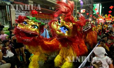 တရုတ် ရိုးရာ ခြင်္သေ့ ၊ နဂါး အကအလှ စွမ်းရည် ပြိုင်ပွဲ ကျင်းပမှုများအား တွေ့ရစဉ်(ဆင်ဟွာ)