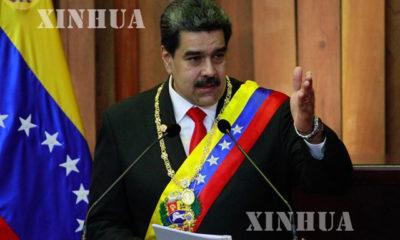 ဗင်နီဇွဲလားနိုင်ငံ သမ္မတ နီကိုးလပ်စ်မာဒူရိုအား တွေ့ရစဉ် (ဆင်ဟွာ)