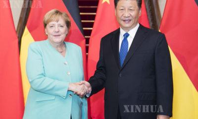 တရုတ်နိုင်ငံ သမ္မတ ရှီကျင့်ဖိန်နှင့် ဂျာမနီနိုင်ငံ ဝန်ကြီးချုပ် အိန်ဂျလာ မာကဲလ်အား တွေ့ရစဉ် (ဆင်ဟွာ)