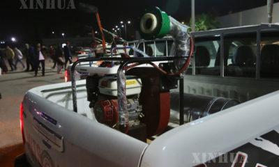 လစ်ဗျားနိုင်ငံ ထရီပိုလီမြို့တွင် covid-19 ကာကွယ် ထိန်းချုပ်ရေးအတွက် ပိုးသတ်ဆေးဖျန်းကိရိယာ တင်ဆောင်ထားသည့် မော်တော်ယာဉ်များအား တွေ့ရစဉ် (ဆင်ဟွာ)