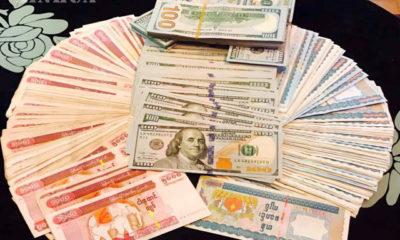 မြန်မာကျပ်ငွေ နှင့် အမေရိကန်ဒေါ်လာ အားတွေ့ရစဉ် (ဆင်ဟွာ)