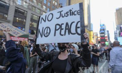 အမေရိကန် နိုင်ငံ နယူးယောက်မြို့ Manhattan မြို့၌ ဆန္ဒပြမှုများအား မေ ၃၁ ရက်က တွေ့ရစဉ်(ဆင်ဟွာ)