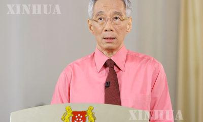စင်ကာပူ နိုင်ငံ ဝန်ကြီးချုပ် လီရှန်လွန်း မိန့်ခွန်းပြောကြားနေသည် ကို တွေ့ရစဉ်(ဆင်ဟွာ)