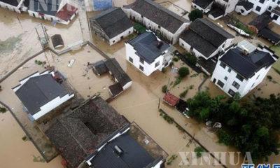 တရုတ် နိုင်ငံ အန်းဟွေး ပြည်နယ် တွင် ရေဘေး ဖြစ်ပွား ခဲ့သည် ကို မြင်တွေ့ရစဉ်(ဆင်ဟွာ)