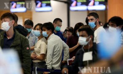 ရန်ကုန်လေဆိပ်တွင် ခရီးသည်များသွားလာနေကြစဉ် (ဆင်ဟွာ)