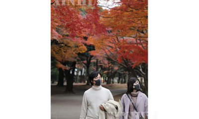 ဂျပန်နိုင်ငံတိုကျိုမြို့တွင် နှာခေါင်းစည်းတပ်ဆင်သွားလာနေသူများအား ဒီဇင်ဘာ ၁၂ ရက်က တွေ့ရစဉ်(ဆင်ဟွာ)