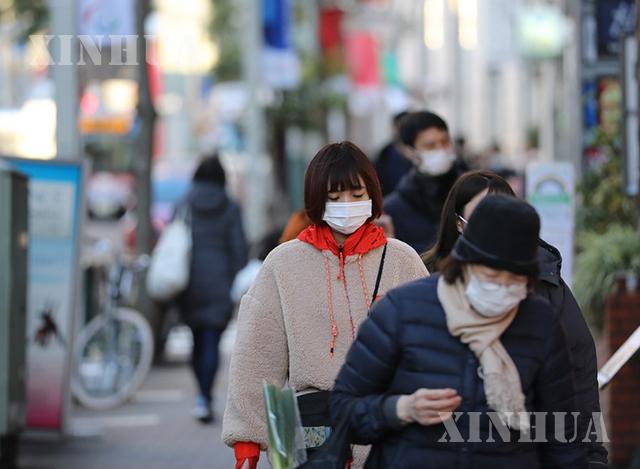 ဂျပန်နိုင်ငံ တိုကျိုမြို့တွင် နှာခေါင်းစည်းတပ်သွားလာနေသူများအား ၂၀၂၀ ပြည့်နှစ် ဒီဇင်ဘာ ၃၁ ရက်က တွေ့ရစဉ်(ဆင်ဟွာ)