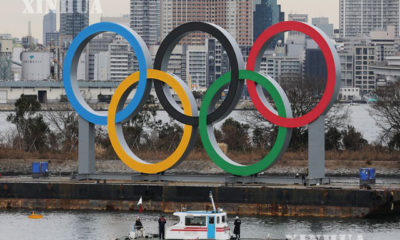ဂျပန်နိုင်ငံ တိုကျိုမြို့ရှိ Odaiba Marine ပန်းခြံတွင် Olympic သင်္ကေတအား တွေ့ရစဉ် (ဆင်ဟွာ)
