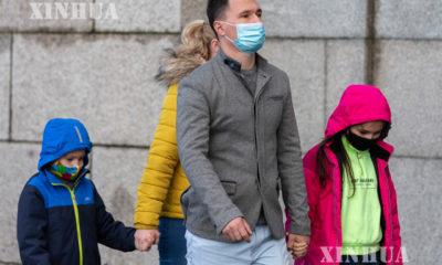 ဗြိတိန်နိုင်ငံ လန်ဒန်မြို့လယ်တွင် လူများ နှာခေါင်းစည်းတပ်၍ သွားလာနေသည်ကို မြင်တွေ့ရစဉ်(ဆင်ဟွာ)