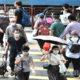 ဟောင်ကောင်ဒေသ၌ နှာခေါင်းစည်းတပ်ဆင်သွားလာနေသူများအား တွေ့ရစဉ်(ဆင်ဟွာ)